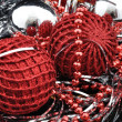 Red christmas balls over black — Stock Photo #3999656