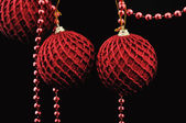 Red christmas balls over black — Foto de Stock