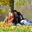 Family in park on autumn — Stock Photo