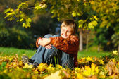 Cheerful child in autum meadow — Stock Photo