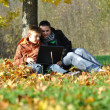 Family in park on autumn — Stock Photo #4166292