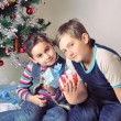 Kids with their christmas presents — Stock Photo #4499198