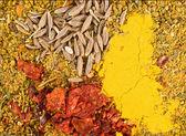 Zira seeds and curry — Stock Photo