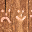 Royalty-Free Stock Photo: Emoticons at Timber