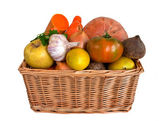 Wicker basket with fruits and vegetables — Stock Photo