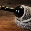 Bottle of wine wrapped with rope — Stock Photo #5267723