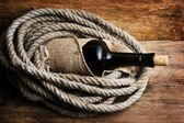 Bottle wrapped with rope — Stockfoto