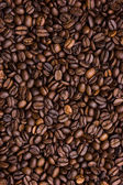 Background of black coffee beans — Stock Photo