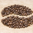 Coffee beans on the board - Stock Photo