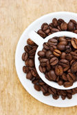 Cup with coffee beans — Foto Stock