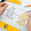 Stock Photo: Drawing at home with construction tools