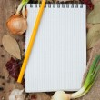 Notebook for recipes on the background of spices — Stock Photo
