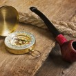 Compass and a pipe with a rope — Stockfoto