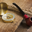Compass and a pipe with a rope — Stok fotoğraf