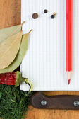 Notebook to write recipes with spices — Stockfoto