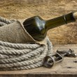 Bottle wrapped with rope — Stock Photo #5357691