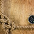 Stock Photo: Compass with a rope
