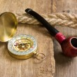 Compass and a pipe with a rope — Stock Photo #5357740