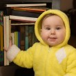 Baby and bookcase — Stock Photo