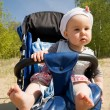 Baby girl in the stroller — Stock Photo