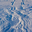 Stock Photo: Snowdrift and tire tracks