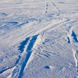 Snowdrift and tire tracks — Stock Photo
