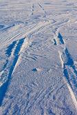 Snowdrift and tire tracks — Stock Photo