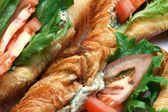 Croissant with filling on white plate — Stock Photo