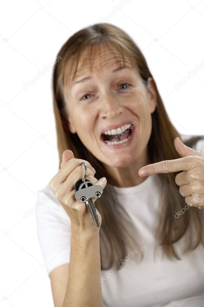 Happy woman to point at  her own car key and car on a key ring in the hand, isolated on white — Stock Photo #4784743