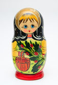 Russian matryoshka doll on white background — Stock Photo