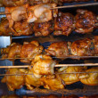 Roasted chicken on real fire preparing for sel — Stock Photo