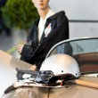 Dolly with helm in front of she on sports car — Stock Photo #4123522