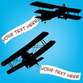 Old planes with comercial banners — Stock Photo