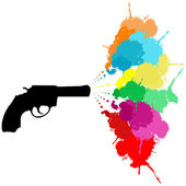 Black revolver with colored paint splashes — Stock Photo