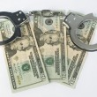 Close-up handcuffs and money — Stock Photo