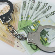 Close-up handcuffs and money — Stock Photo #4003052