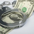 Close-up handcuffs and money — Stock Photo #4003076