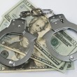 Close-up handcuffs and money — Stock Photo #4003104
