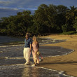 Senior couple walking on a maui beach — 图库照片