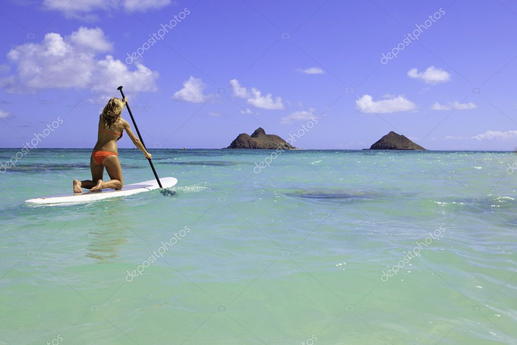 Teenage girl in orange bikini on a paddle board in hawaii — Stock Photo #4108284