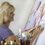 Older woman painting in her studio — Stock Photo