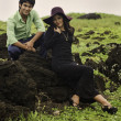 Foto Stock: Eurasisiblings lounging in field