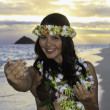 Royalty-Free Stock Photo: Woman dancing hula by the ocean