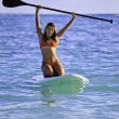 Teenage girl on a stand up paddle board — Stock Photo