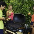 Three friends at a barbecue party in hawaii — Stock Photo #4862883