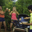 Three friends at a barbecue party in hawaii — Stock Photo #4862907