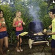 Three friends at a barbecue party in hawaii - Stock Photo