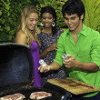 Friends at a barbecue party — Stock Photo