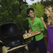 Couple having an outdoor barbecue — Stock Photo #4917380