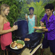 Three friends at a barbecue party in hawaii — Stock Photo #4917413